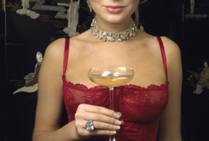 Woman Holding a Glass of Champagne --- Image by © Serge Krouglikoff/Corbis